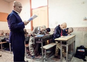 Iranian small town teacher shaves head, becomes unlikely national hero